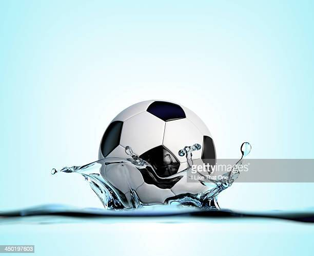 football falling into water - atomic imagery ストックフォトと画像