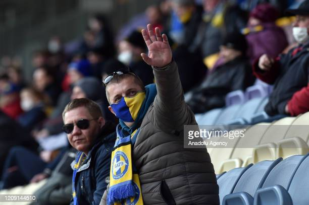 A football fan attends the Belarus Championship football match between FC BATE and FC Rukh in the town of Borisov some 70 km east of Minsk on April 4...