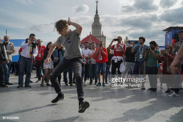 A football fan from Russia cossack dances at the official FIFA Fan Fest at Moscow State University where fans will watch the first World Cup game...