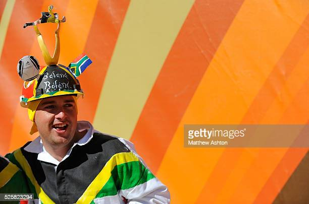A football fan from South Africa wearing a Makarapa hat