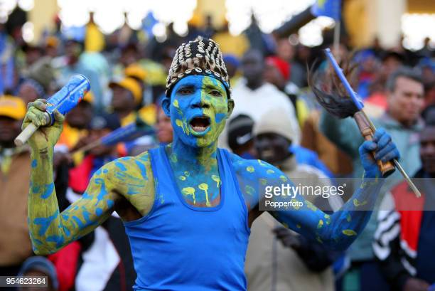 A football fan from the Democratic Republic of the Congo supports his team during the Africa Cup of Nations Group B match between Angola and the...