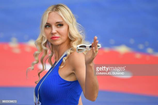 A football fan gestures before the Russia 2018 World Cup quarterfinal football match between Sweden and England at the Samara Arena in Samara on July...
