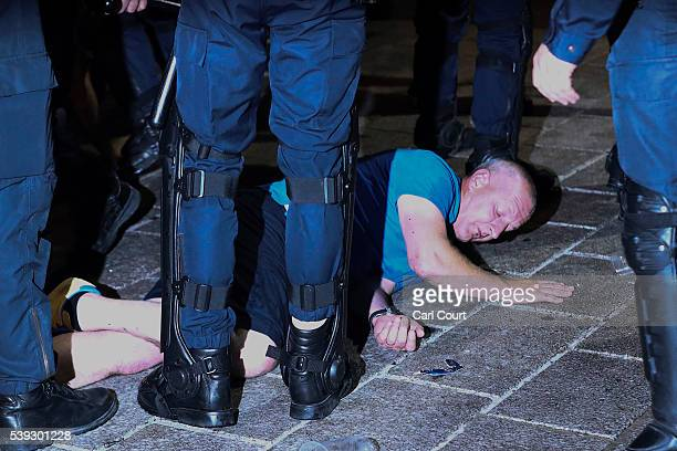 A football fan lies on the ground surrounded by police as England fans clash with police in Marseille on June 10 2016 in Marseille France Football...