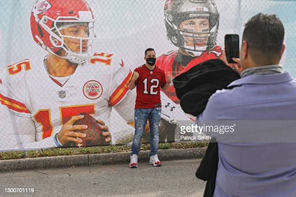 Football fan poses for a picture prior to Super Bowl LV outside of Raymond James Stadium on February 6, 2021 in Tampa, Florida. The Kansas City...