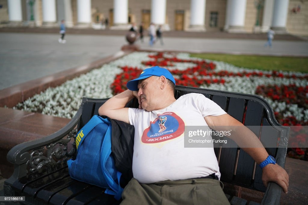 A football fan relaxes in the morning sunshine near Red Square ahead of the World Cup on June 12, 2018 in Moscow, Russia. Moscow and Russia are gearing up for the start of the World Cup tournament. FIFA expects more than three billion viewers for the World Cup that begins this week in Russia.