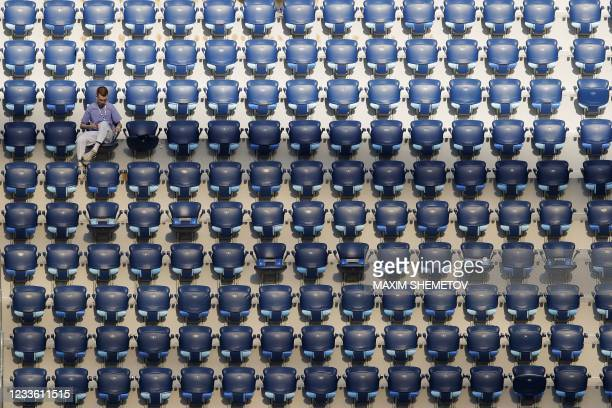 Football fan sits in the stands before the UEFA EURO 2020 Group E football match between Sweden and Poland at Saint Petersburg Stadium in Saint...