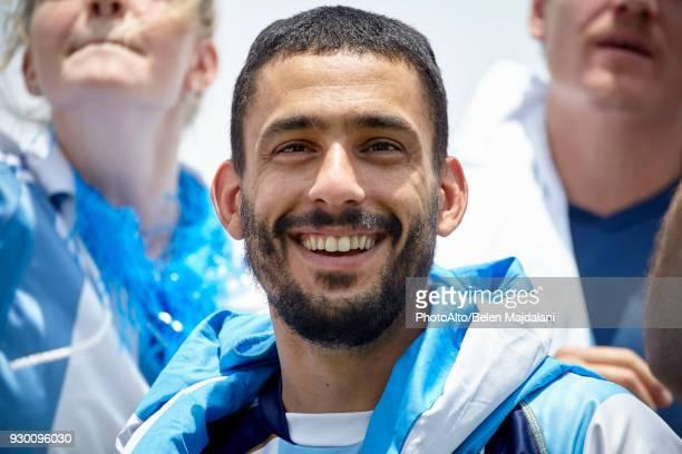 Football fan smiling, portrait