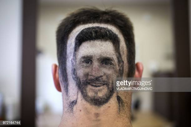 Football fan sports a hair tattoo showing the portrait of Argentinian football player Lionel Messi at a hair salon in Novi Sad, Serbia, on June 10,...
