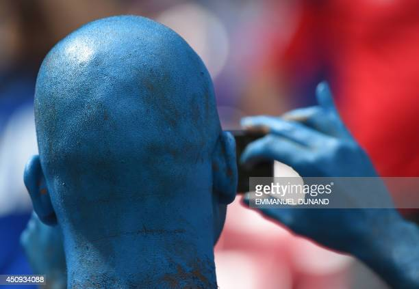 Football fan takes a selfie prior to a Group D football match between Italy and Costa Rica at the Pernambuco Arena in Recife during the 2014 FIFA...