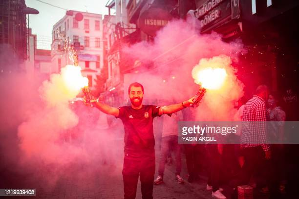Football fan warms up prior to the football match Besiktas vs Antalyaspor in Istanbul on June 13, 2020. - The Turkish Super League resumes after an...