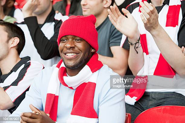 football fan watching match - fan enthusiast stock photos and pictures