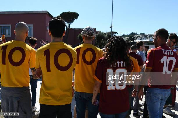 Football fan wear teeshirts the number 10 in honor of AS Roma's captain Francesco Totti as they arrive at the Olympic Stadium for the Italian Serie A...