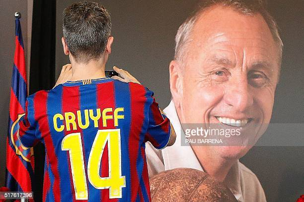 A football fan wearing a jersey of FC Barcelona pays tribute to late Dutch football star Johan Cruyff in a special condolence area set up at Camp Nou...