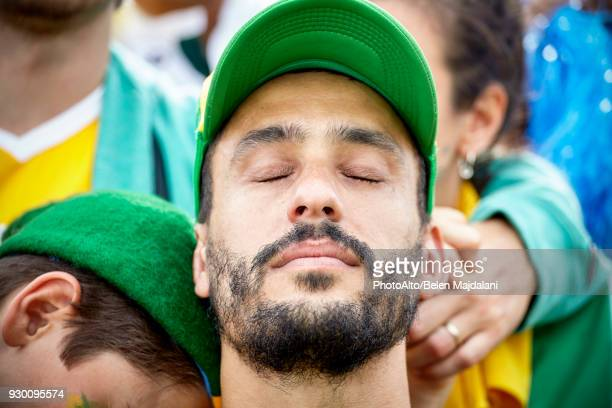 football fan with head back and eyes closed in disappointment - fan enthusiast stock pictures, royalty-free photos & images