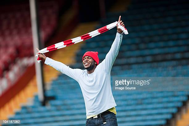 football fan with scarf - fan enthusiast stock photos and pictures