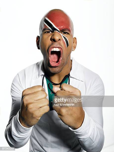 Man with Trinidad and Tobago flag painted on face, portrait