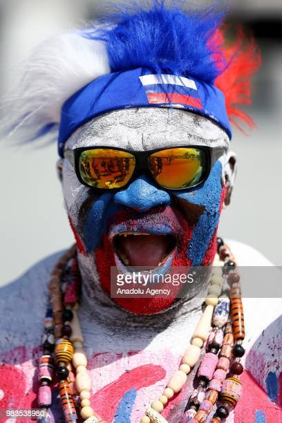 A football fan Zomo from Cameroon arrives at the Volgograd Arena to follow the 2018 FIFA World Cup Russia Group A match between Saudi Arabia and...