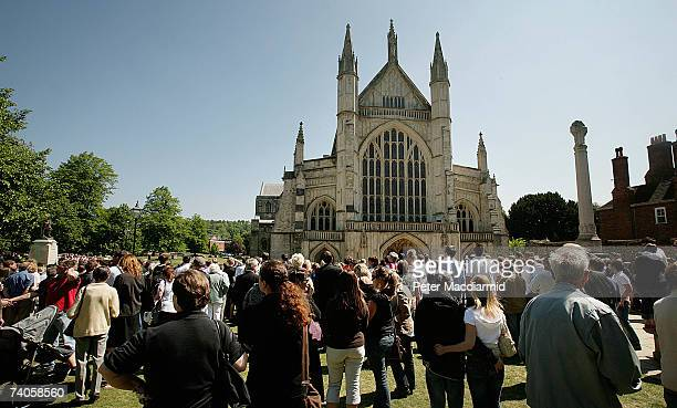 Football fans and mourners stand outside Winchester Cathedral for the funeral of footballer Alan Ball on May 3 2007 in Winchester England Alan Ball...