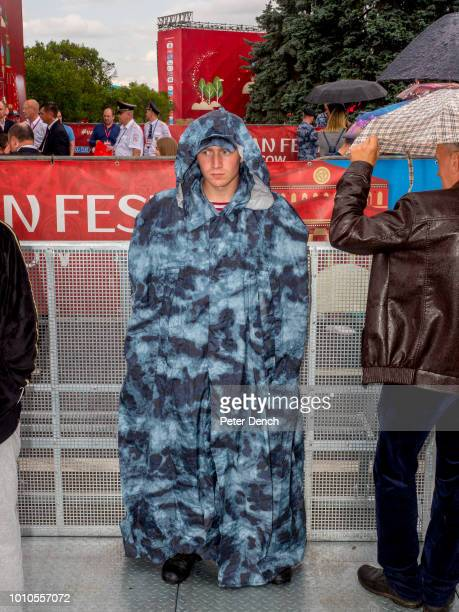Football fans and police attempt to stay dry at the FIFA Fan Festlocated at Vorobyovy Gory with a venue capacity of 25000 The 21st FIFA World Cup...