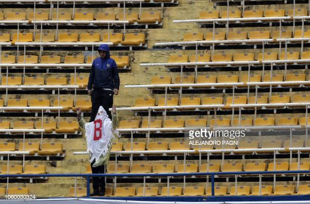 Football fans are pictured at La Bombonera stadium in Buenos Aires after the suspension due to heavy rain of the Copa Libertadores 2018 first leg...