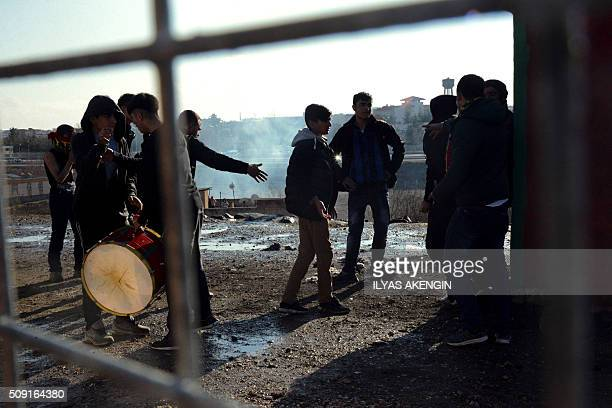 Football fans are seen as Turkish riot police use tear gas to disperse them around the stadium on February 9 2016 in Diyarbakir southeastern Turkey...
