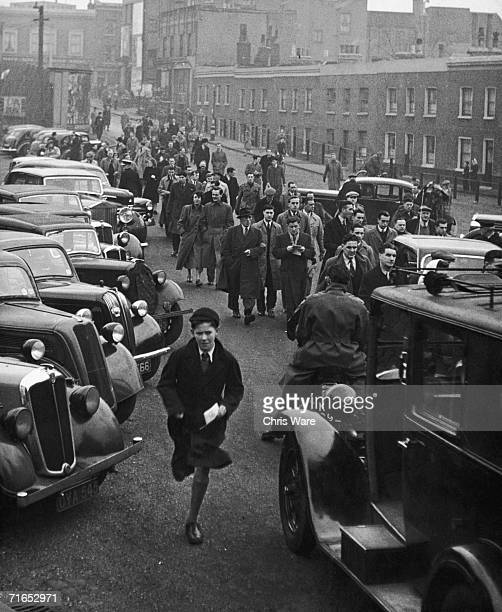 Football fans arrive at a ground before a match February 1949