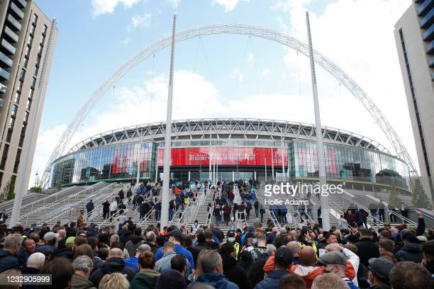 Football fans arrive at Wembley Stadium ahead of the FA Cup final on May 15, 2021 in London, England. A limited number of around 21,000 fans, subject...