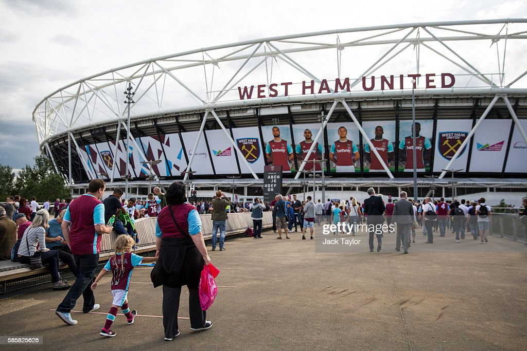 Football fans arrive to watch West Ham United v NK Domzale at the London Stadium on August 4, 2016 in London, England. West Ham United play for the first time tonight at the former Olympic Stadium, which hosted the London 2012 Games, since moving from their former home at Upton Park.