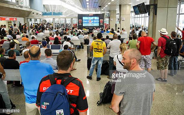 Football fans at Brasilia airport, Brazil