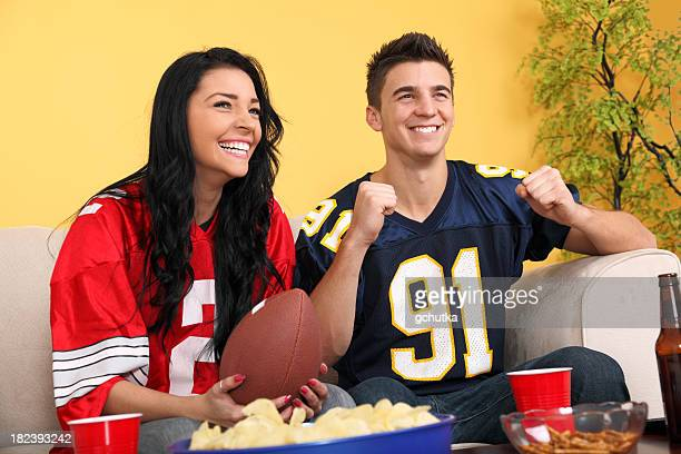 football fans at home - gchutka stock pictures, royalty-free photos & images