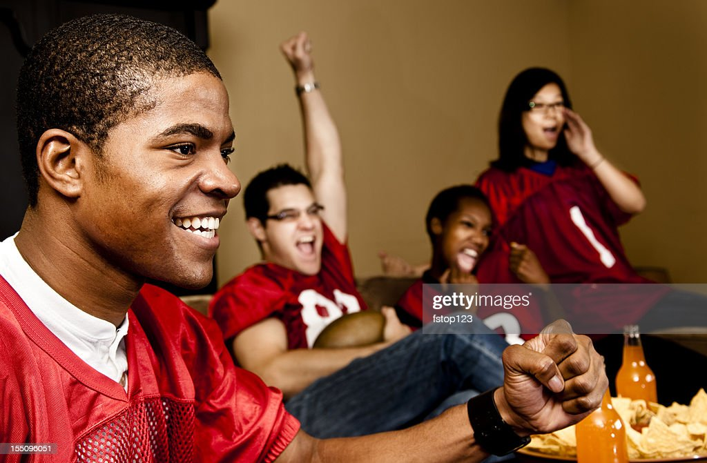 Football fans at home watching, cheering. Sports game on television. : Stock Photo