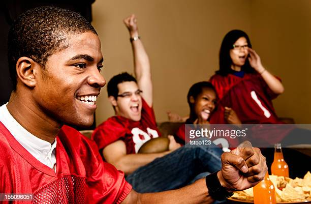 football fans at home watching, cheering. sports game on television. - american football sport stockfoto's en -beelden