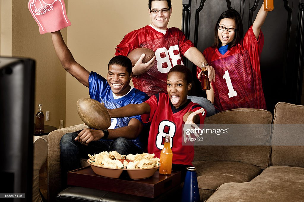 Football fans at home watching the game : Stock Photo