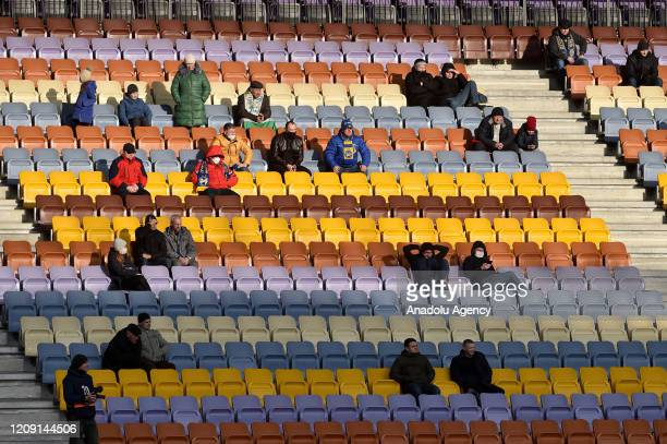 Football fans attend the Belarus Championship football match between FC BATE and FC Rukh in the town of Borisov some 70 km east of Minsk on April 4...