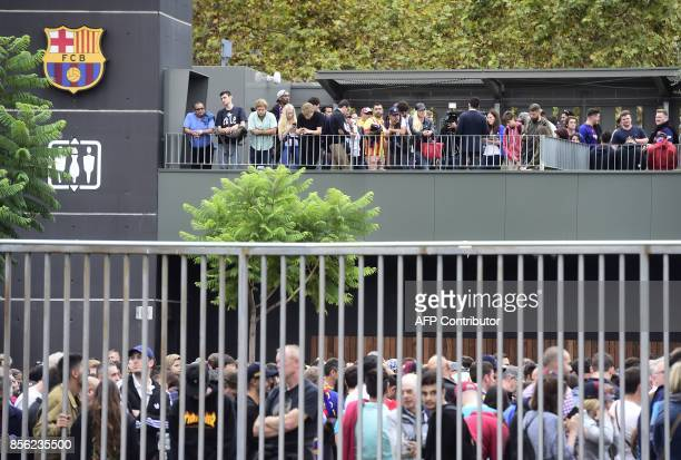 Football fans await outside the stadium before the Spanish league football match FC Barcelona vs UD Las Palmas at the Camp Nou stadium in Barcelona...