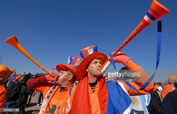 Football fans blow vuvuzelas in support of The Netherlands prior to the start of the South Africa 2010 World Cup football match between The...