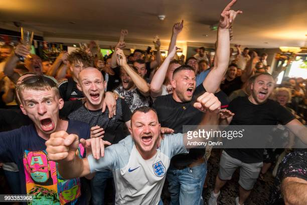 Football fans celebrate at the final whistle as England beat Sweden in the World Cup Quarter Finals in The Lord Stamford public house on July 7 2018...