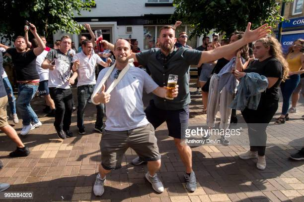 Football fans celebrate at the final whistle as England beat Sweden in the World Cup Quarter Finals outside The Lord Stamford public house on July 7...