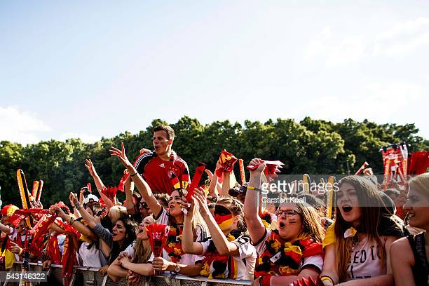 Football fans celebrate the first goal for Germany during the 2016 UEFA European Championship match Germany v Slovakia at a public viewing area on a...
