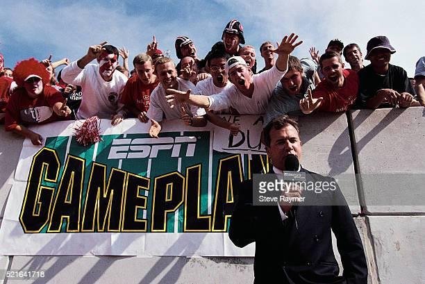 Football Fans Celebrating Above ESPN Announcer