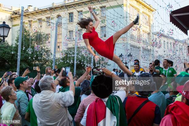 Football fans cheer at Moscow downtown on June 16 2018 in Moscow Russia