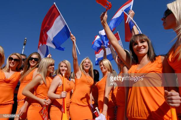 Football fans cheer for The Netherlands prior to the start of the South Africa 2010 World Cup football match between The Netherlands and Denmark on...