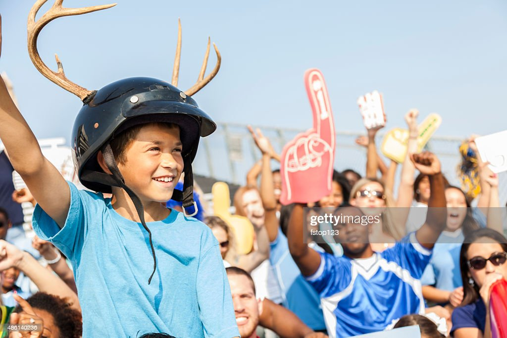 Football fans cheer for their team during sports event. Stadium. : Stock Photo