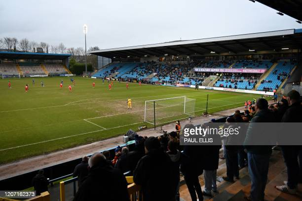 Football fans cheer for their team during the national league football match Halifax Town versus Ebbsfleet United at the Shay stadium in Halifax,...