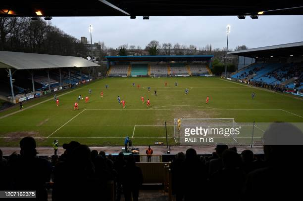 Football fans cheer for their team during the national league football match Halifax Town versus Ebbsfleet United at the Shay stadium in Halifax...