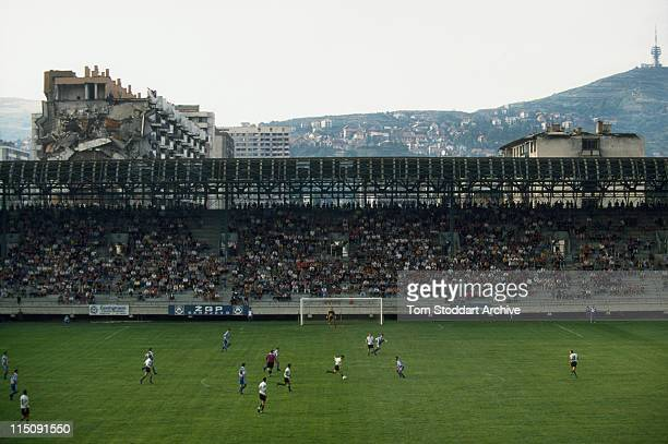 Football fans cheer their team during a game at the Grbavica Stadium in Sarajevo as the city begins to come to life again after four years of siege...
