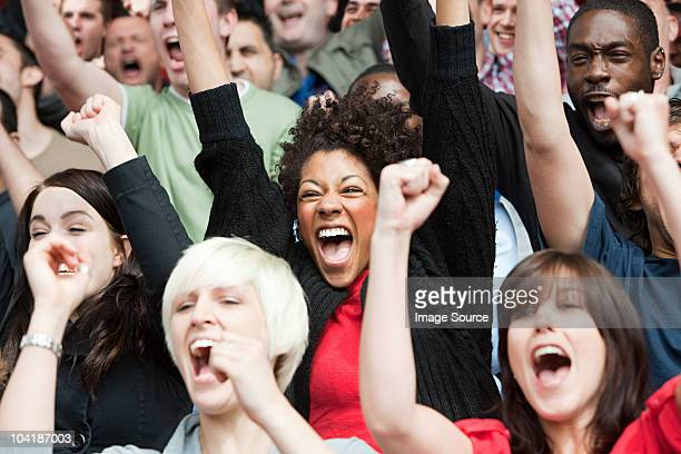 football fans cheering - cheering stock pictures, royalty-free photos & images