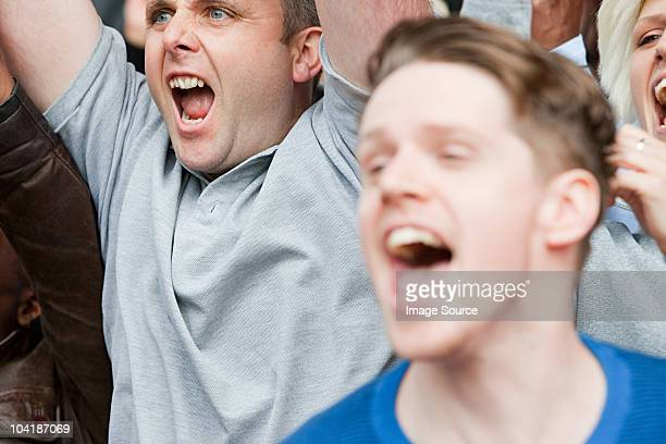 football fans cheering - crowd cheering stock pictures, royalty-free photos & images