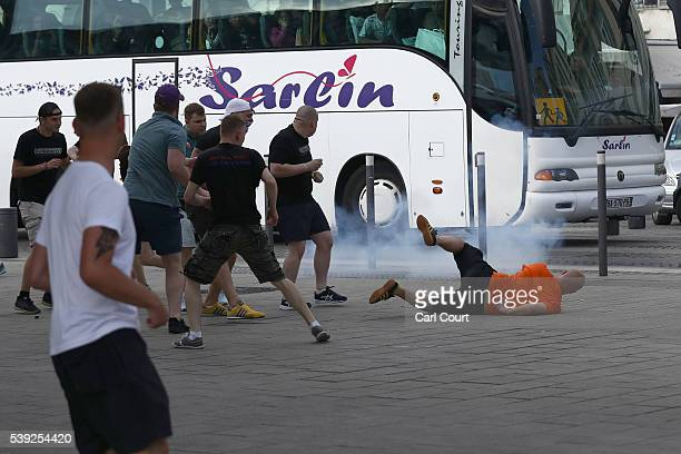 Football fans clash in Marseille ahead of the opening game of the UEFA Euro 2016 tournament later today on June 10 2016 in Marseille France Football...