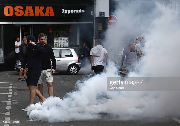 Football fans during clashes with police on June 15 2016 in Lille France Football fans from around Europe have descended on France for the UEFA Euro...